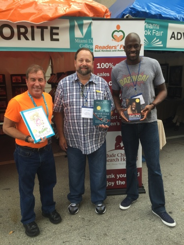 "With Eddie Price and Kevin ""Special K"" Daley, 10-year former captain and showman of the Harlem Globetrotters, all showing oiur award-winning books."
